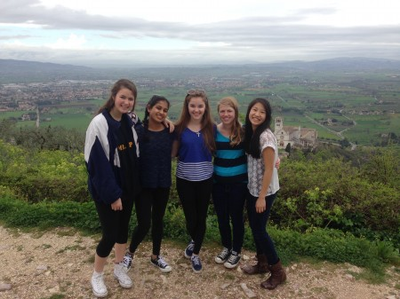 Sophomores, Madeleine Driscoll, Maya Sheth, Amara Clough, Brianna Dooley, and Caroline Gao enjoy the view from atop the fortress in the little town of Assisi. The AP European class visited this town on their drive between Florence and Rome. The main attraction of the town is the basilica of St. Francisco.  Photo Courtesy of Brianna Dooley