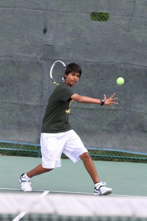 """Rohan Dsouza, 10, sets his feet to meet a ball with a forehand. Dsouza plays year-round tennis at Camargo Racquet Club, and feels excited and determined for this year's tryouts. """"Well obviously I have personal goals that I want to meet regarding how I perform, but as always I know that no matter what it's about to be an awesome experience. It's really a cool opportunity to play for Sycamore. Even if it is a little harder to make the teams,"""" said Dsouza. Photo courtesy of McDaniel's Photography."""