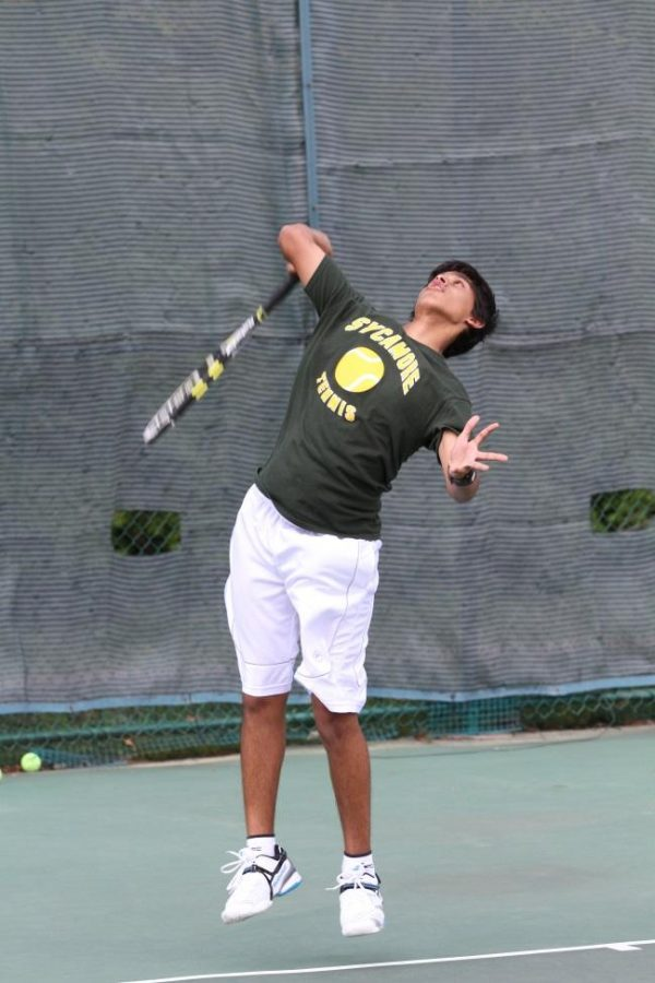 """Rohan Dsouza, 10, explodes upwards for a serve. """"This year is going to be great. I can't wait to bond with my bros,"""" said Dsouza. Tennis tryouts will begin on Mon., Mar. 10 at Western & Southern. Photo Courtesy of McDaniel's Photography."""
