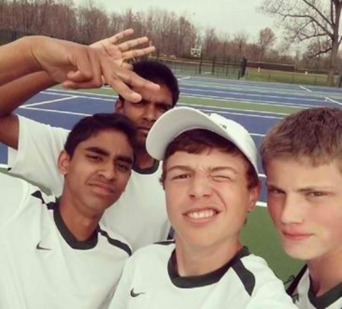 """A """"selfie"""" with the new courts taken by Alex Wittenbaum, 11. Also in the photo with with now lined courts are Deepak Indrakanti, 11, Noah Stern, 9, and Nakul Narendran, 11, all members of the A team. The courts are scheduled to be played on within the next few weeks."""