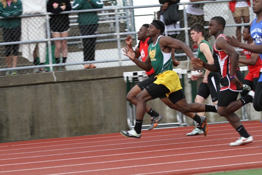 Ronnie Williams, 12, fights for the lead with a runner from Colerain in the 100 meter dash. Williams placed second in the race.