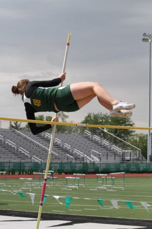 Molly Gearin, 11, vaults over seven feet at the Greater Miami Conference Championships. She and I have been pole vaulting teammates since our eighth grade year- the year the pole vaulting program was brought back to SJHS. Fear in competition is a constant obstacle to overcome. It is the mental and emotional strength of the individual that pushes the fear aside to achieve success. Photo courtesy of McDaniel's Photography.