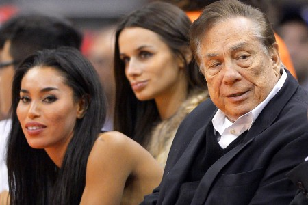 Donald Sterling and V. Stiviano are above sitting court side at a Clippers game. HE has since been banned from attending any game or participating in any team activity. It has also since been found out that he has prostate cancer and has been battling it for some time now. PC: Josh Patterson