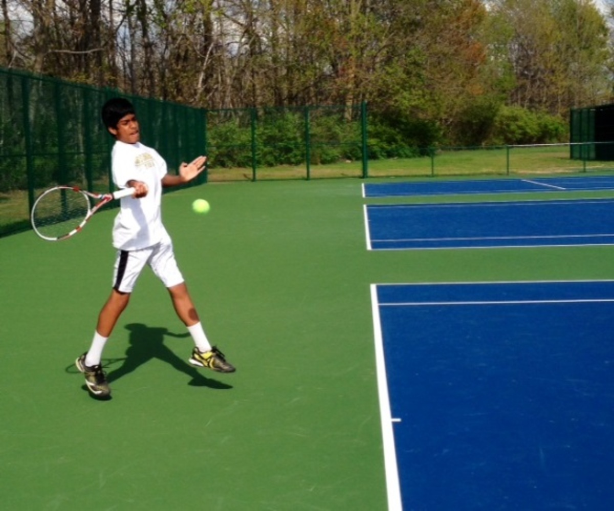 Varun Kalaiarasan, 9, practices on the brand new courts. This is the first practice the JV team has had on the new courts. Kalaiarasan hits a forehand drive during practice.