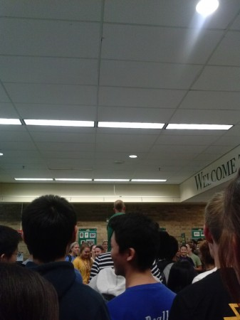 While there was some confusion as students were herded through the halls to the main lobby, the spontaneous event was undeniably a success. Both athletic teams were present, along with their coaches, and student support overflowed in a cacophony of cheering and noise. It was so packed that speakers had to stand on a chair in order to be seen.