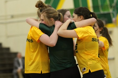 Lindsay Altemuehle, 9, hugging the seniors after their performance. The underclassmen are now getting ready for tryouts in a couple weeks. The girls are hanging up posters around SHS and making a video about the team. Photo courtesy of McDaniel's Photography.