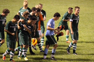 Celebrating after the game-winning goal, the Boys Varsity Soccer team surrounds teammate and senior Yuan Zhang. The team is now 5-1 and takes on Mason at home on Thurs. Sept. 11 at 7 p.m.