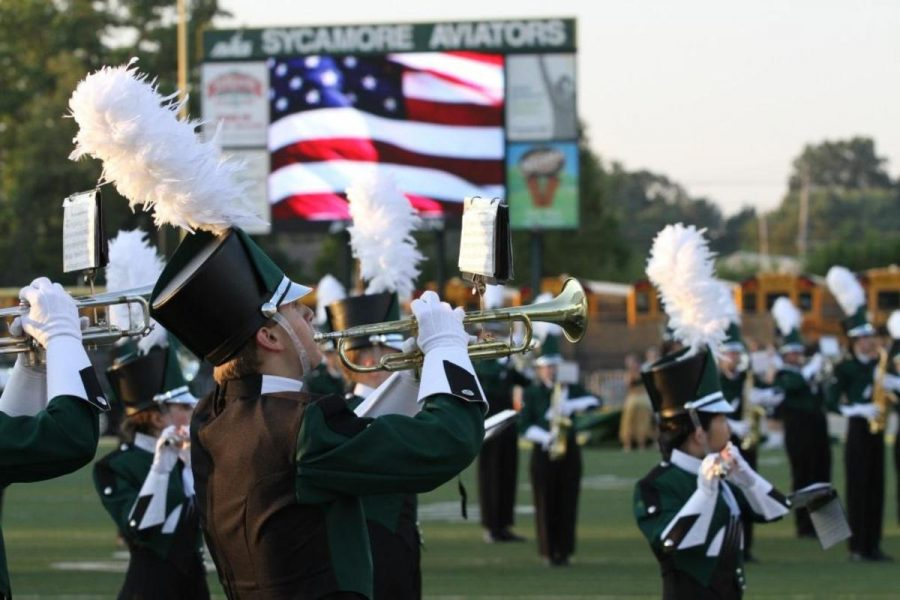 A+member+of+the+marching+band+plays+at+a+football+game.+Members+of+the+marching+band+practice+long+and+hard+every+day+to+improve.+They+perform+at+SJHS.