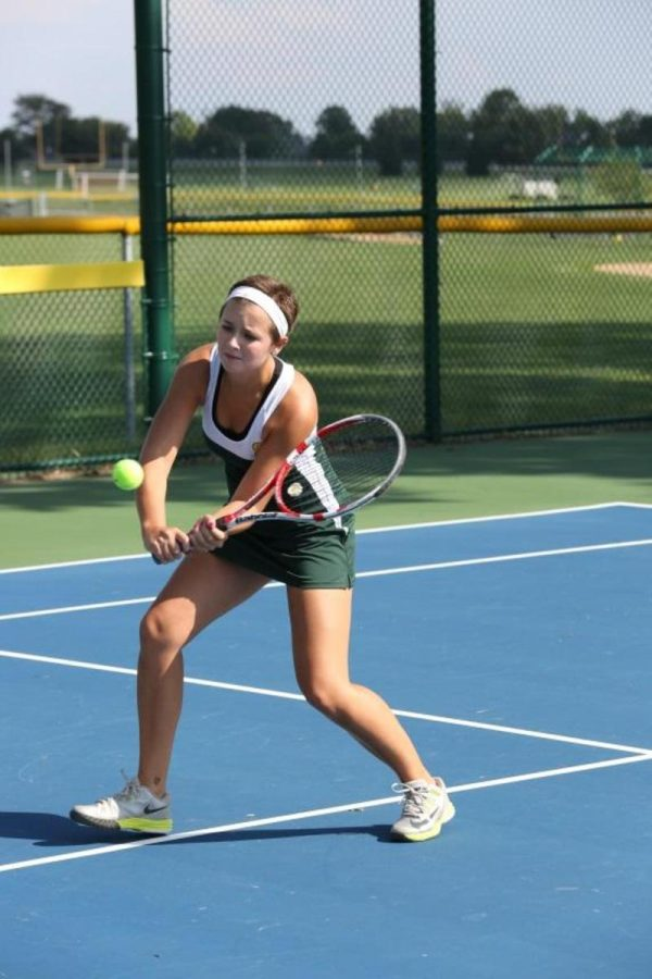 Maggie+Skwara+works+on+her+volleys+during+practice.++She+will+practice+just+as+hard+during+the+off+season+as+she+does+during+the+season.++She+is+practicing+at+the+SHS+courts+with+her+team.