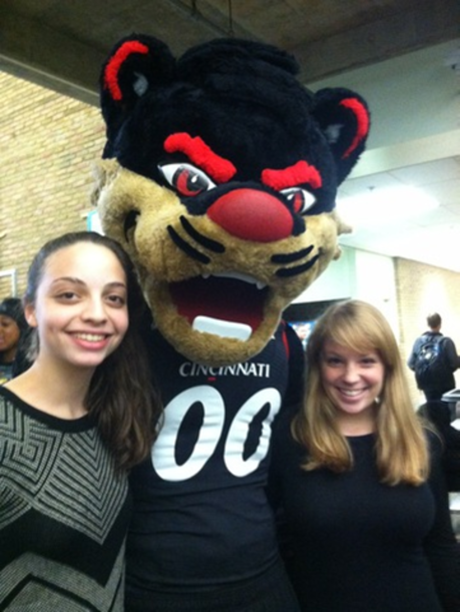 Sophomores Hannah Frey and Hannah May pose with the Cincinnati Bearcat mascot. The line to take pictures with the mascot expanded rapidly throughout the lunch period. The Aviator mascot spent time interacting with the Bearcat during the duration of his stay, when picture opportunities were available with both.
