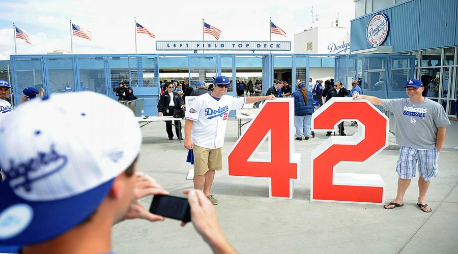+++Fans+pose+with+Jackie+Robinson%E2%80%99s+retired+number+outside+of+Dodgers+Stadium.+Robinson+played+with+the+Dodgers+for+10+years.+Robinson%E2%80%99s+number+is+retired+by+every+MLB+team.%0A