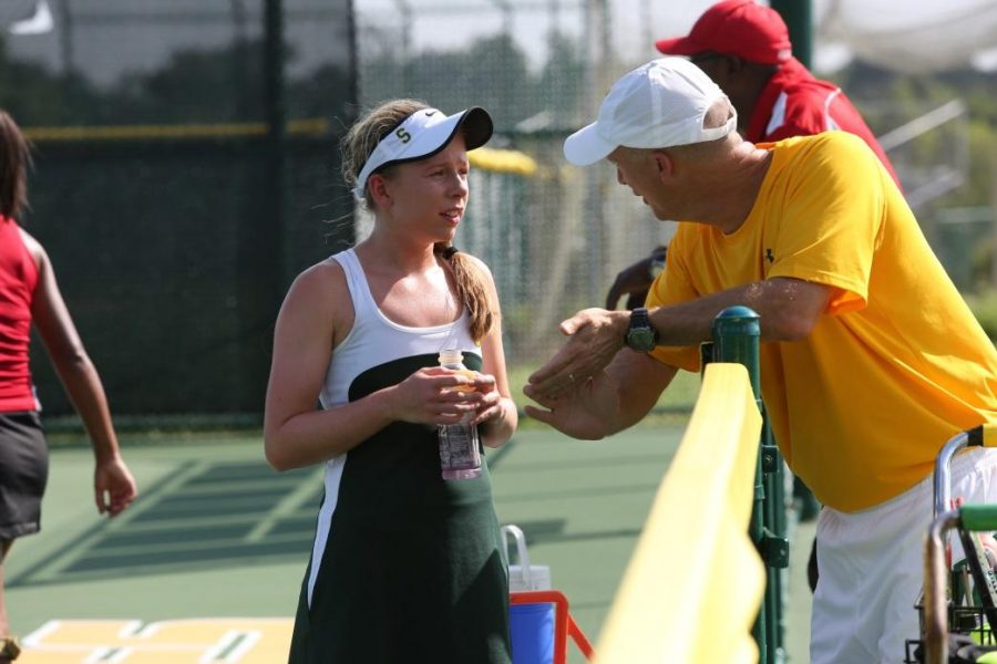 Alexa+Abele+plays+a+match+against+Princeton+at+SHS.+She+receives+advice+from+Coach+Mike+Teets+during+a+changeover.+Sycamore+beat+Princeton+3-1+at+the+end+of+the+day.
