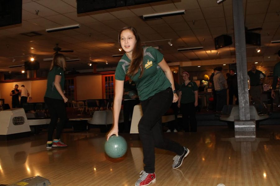 Jennifer+Weber+prepares+to+roll+the+ball.+She+is+sporting+her+Girls+Bowling+uniform.+In+the+background%2C+her+teammates+are+supporting+and+watching+her.