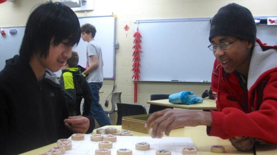 Students+play+Chinese+Chess.++The+games+pieces+are+round%2C+and+totally+different+than+American+chess.++Pieces+include+cannons+and+generals+replace+kings.
