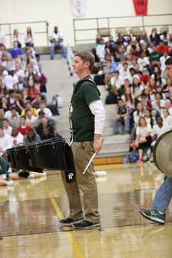 Junior Jack Good plays the fight song with his fellow drum line members.