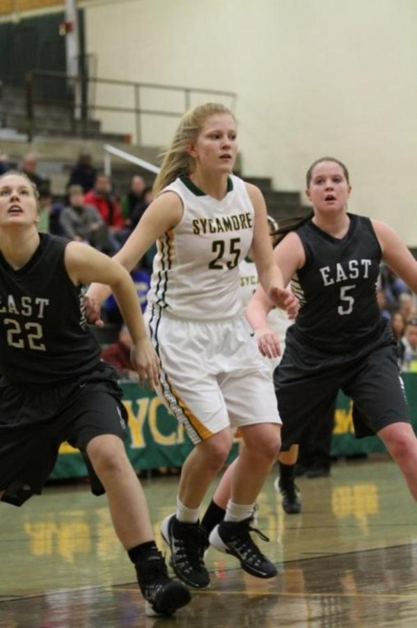Rushing+in+for+a+rebound%2C+junior+Evelyn+Goodyear+battles+the+Lakota+East+opponents.+The+girls+basketball+team%E2%80%99s+first+game+is+against+Ursuline+Academy+in+the+Crosstown+Shootout.+Photo+Courtesy+of+McDaniel%E2%80%99s+Photography.+