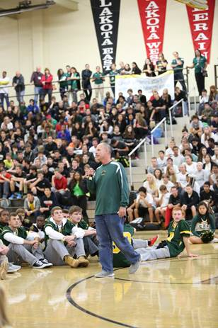 Football coach, Mr. Scott Dattilo gives a pump up speech to the football players and the school. This was the wrap up for the pep rally.