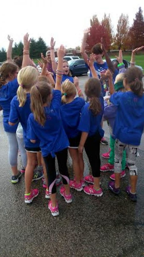 The+girls+from+the+Symmes+branch+doing+a+cheer+after+they+completed+the+practice+5k.++For+many+this+was+their+first+serious+running+experience.++%E2%80%9CIt+was+fun+learning+their+names+and+cheering%2C%E2%80%9D+Martinson+said.++Photo+courtesy+of%3A+Meredith+Gottliebson