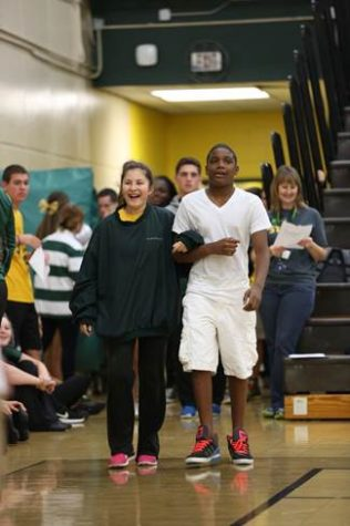 Freshmen homecoming prince and princess Michael Underwood and Sivan Yarchi walk with their fellow court members.