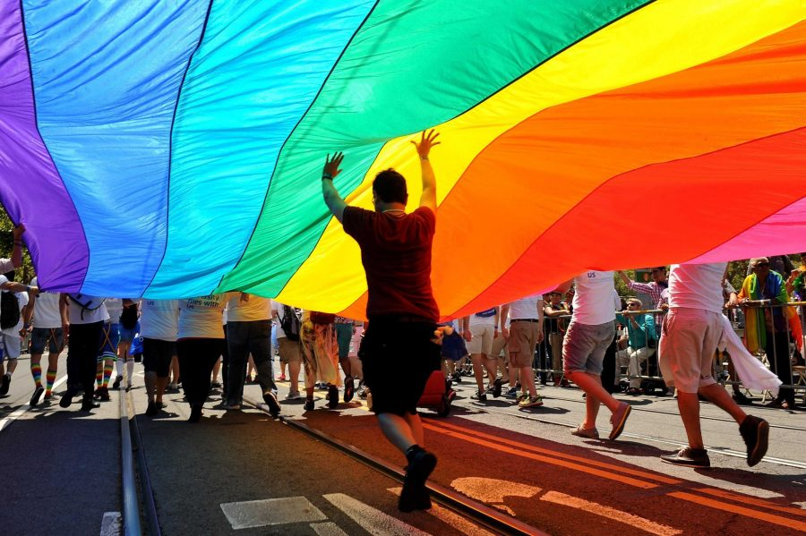 A rainbow flag engulfs a San Francisco street during a pride parade. California legalized same-sex marriage June 28, 2013 with the overturning of Proposition 8. California's hearing inspired other states to follow suit.
