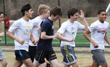 Some returning members of last year's winter track team run a workout with friends.  Many upperclassman were eager to get back into the season for the season for the social side.  Some freshmen are also excited to try indoor track for first time.
