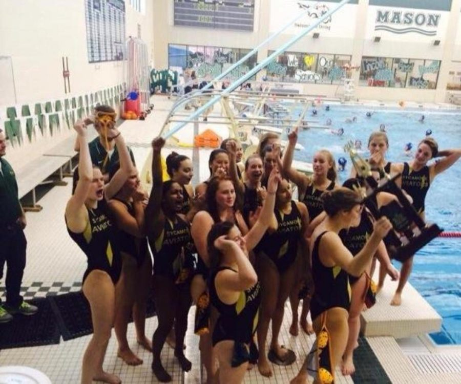 Varsity+Water+polo+girls+celebrate+their+win+against+Milford+and+receive+the+third+in+state+trophy.+After+a+long+day+and+an+early+loss+against+Napolean+the+team%E2%80%99s+spirits+lift+and+they+rejoice+their+final+victory+of+the+season+at+Mason+High+School.+
