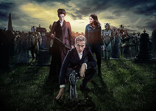 """Promotional image for """"Doctor Who"""" season finale, """"Death in Heaven"""". Featured in the picture are Peter Capaldi as The Doctor, Michelle Gomez as Missy/The Master, and Jenna Louise-Coleman as companion Clara Oswald. The graveyard in the background is the location of the episode's final showdown."""
