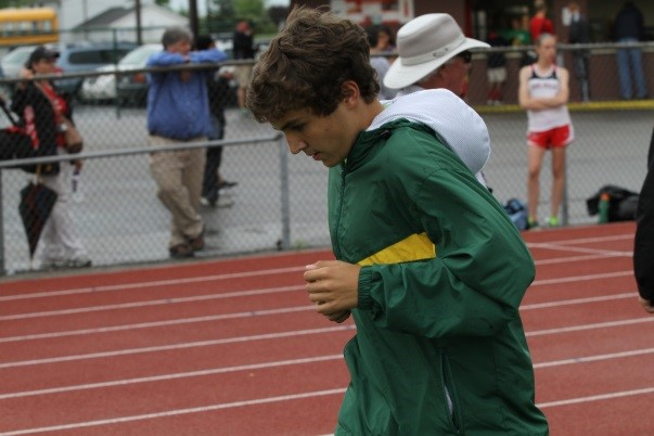 Junior+Jon+Hedrick+warms+up+on+the+track+before+his+event%2C+the+200+meter+sprint.+For+him%2C+the+races+themselves+are+not+the+most+exciting+part+about+track%2C+but+all+the+preparations+beforehand.%0A+++%E2%80%9CThere%E2%80%99s+this+whole+atmosphere+before+a+race%3A+you%E2%80%99ve+got+your+hood+up%2C+the+rain%E2%80%99s+drizzling+on+your+hood+and+you%E2%80%99re+getting+all+pumped+up+because+of+your+music.+You+can%E2%80%99t+hear+anyone+else.+That%E2%80%99s+my+favorite+moment%2C%E2%80%9D+Hedrick+said.%0APhoto+courtesy+of+McDaniel%E2%80%99s+Photography