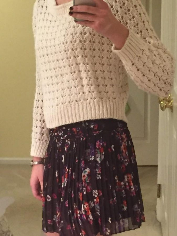 Adding a full on sweater adds a cozy look to an otherwise warm weather skirt. It can be a short sweater or a long sweater. White, grey, and black works with any skirt, but feel free to experiment with different colors and patterns.