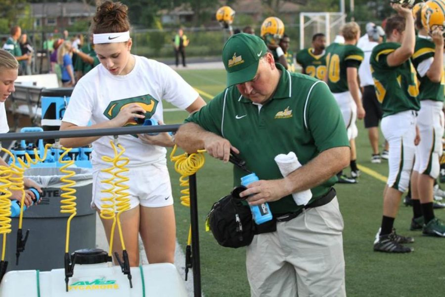 """One of Izworski's jobs is to make sure the players have water. """"This helps the trainers be able to help people who need assistance so they do not have to worry about people being dehydrated,"""" Izworski said. Photo courtesy of McDaniel's photography."""