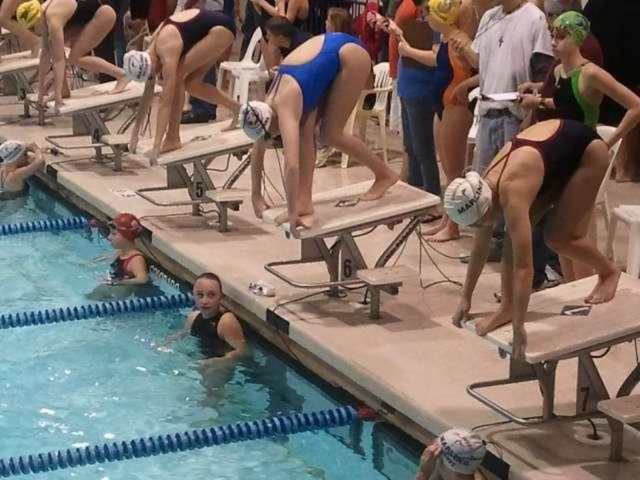 Stephanie+Hong+%28closest%29+stands+in+position+on+the+starting+block+for+her+200+free+race.++She%E2%80%99s+13+and+swimming+at+Keating+Natatorium+at+St.+Xavier.++