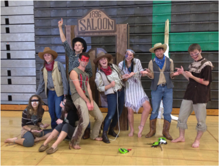 """A group of seniors last year dressed up as cowboys and Indians. They were one of the numerous group costumes at Senior Halloween last year. At the end of the day, awards are given out by category, such as """"Best Group Costume."""" This group did not win an award, but they still had a great time."""