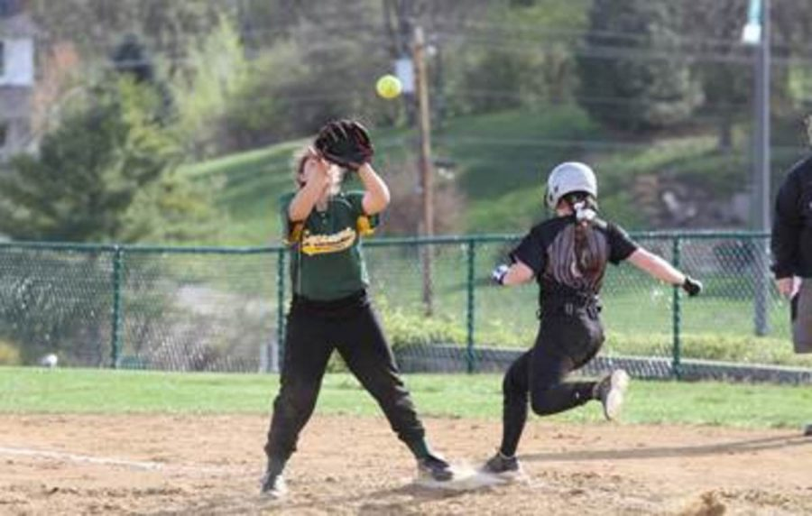Sarah Adler plays short stop. She has an infielder's glove. But sometimes she has to cover first when a player bunts and the first baseman goes to get the ball.