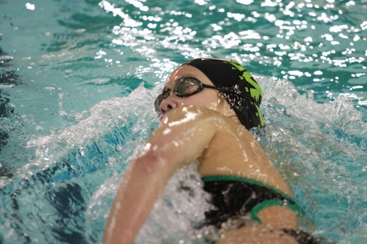 Wu is competing in the 100 yard freestyle. Along with swimming for the high school, she also swims with the Cincinnati Marlins, a local club team. While swimming with the Marlins, Wu had the opportunity to work with the new assistant coach, Stephen Lewis. (photo courtesy of McDaniel's Photography)