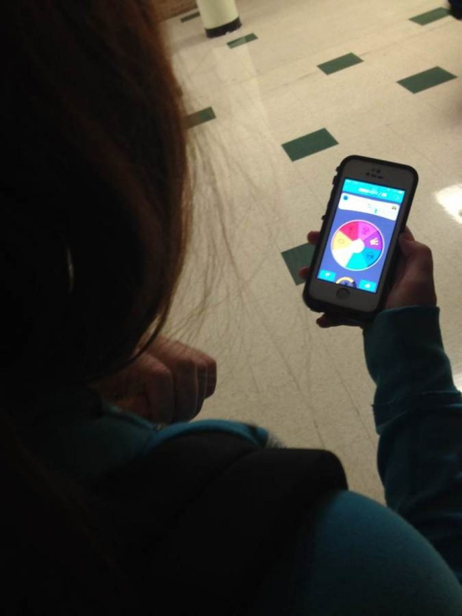 """What are you playing?    What is that game?    Do you know what sport is also known as """"hand egg""""?       In your schools, homes, or basically anywhere you go in the past few days, these type questions have most likely filled the air. This is because of the new app sweeping the nation: Trivia Crack!    """"I've had [Trivia Crack] for like 3 weeks and I got it because my step sister was playing it at dinner and it looked fun,"""" freshman Lilah Foley said.    This app, which is quickly spreading its way to cellphones across the campus, consists of two players who spin a rainbow trivia wheel. On the wheel, there are a few different categories of trivia questions you can answer.     """"People like to prove they're smarter than their friends [when playing against them],"""" freshman Nathan Kraft said.     After the spinner lands on either the history, sports, geography, entertainment, art, science, or a crown (which gives you the power to choose what type of question you want) you have 30 seconds to answer a random trivia question.     If you answer a question correctly, you get to spin the rainbow wheel again. However, if you get the question incorrect, the other opponent gets to spin the wheel.     Once you answer three answers in a row correctly, you have the chance to earn a character, which in this case stands as a trophy. In total, there are six characters you can earn and the first player to win all six, wins the game.     """"It's just the fact that people's self esteem is going up because of the questions they get right and it makes them feel smart,"""" Foley said"""