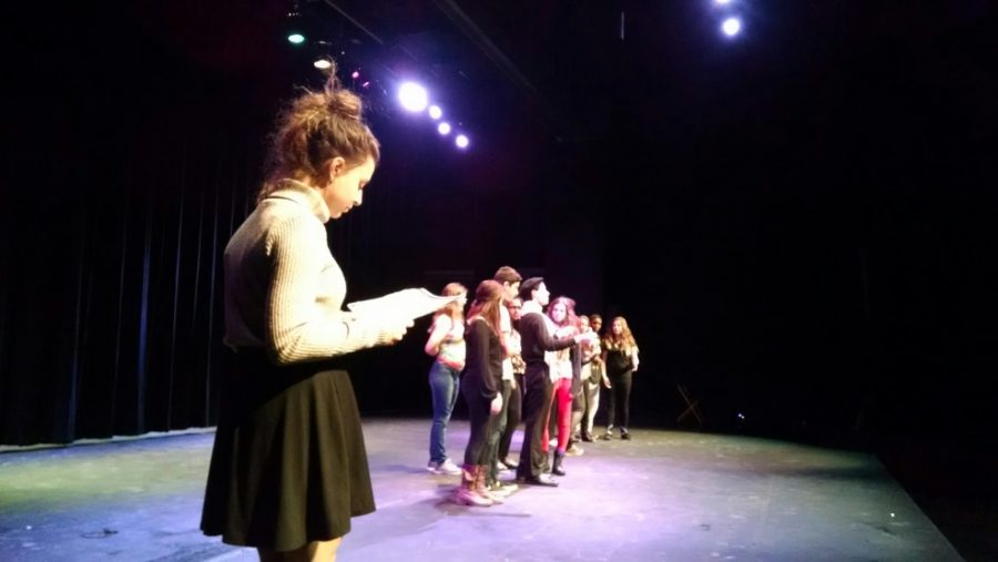 Sophomore+Cagla+Akcadag+and+other+cast+members+rehearse+Competition+Piece.+Akcadag+plays+a+crazed+judge+in+the+midst+of+many+regular+people%2C+who+in+Check+Please-+Take+Three+she+plays+a+normal+girl+in+the+middle+of+many+crazy+blind+date+characters.%0A%E2%80%9CThankfully+we%E2%80%99re+alternating+with+Anderson+in+performing+our+shows%2C+because+I+don%E2%80%99t+think+I+could+switch+in+between+the+perspectives+of+my+characters+quick+enough+to+perform+them+one+after+the+other.+My+parts+are+so+different%2C%E2%80%9D+Akcadag+said.%0APhoto+by%3A+Tori+Swart