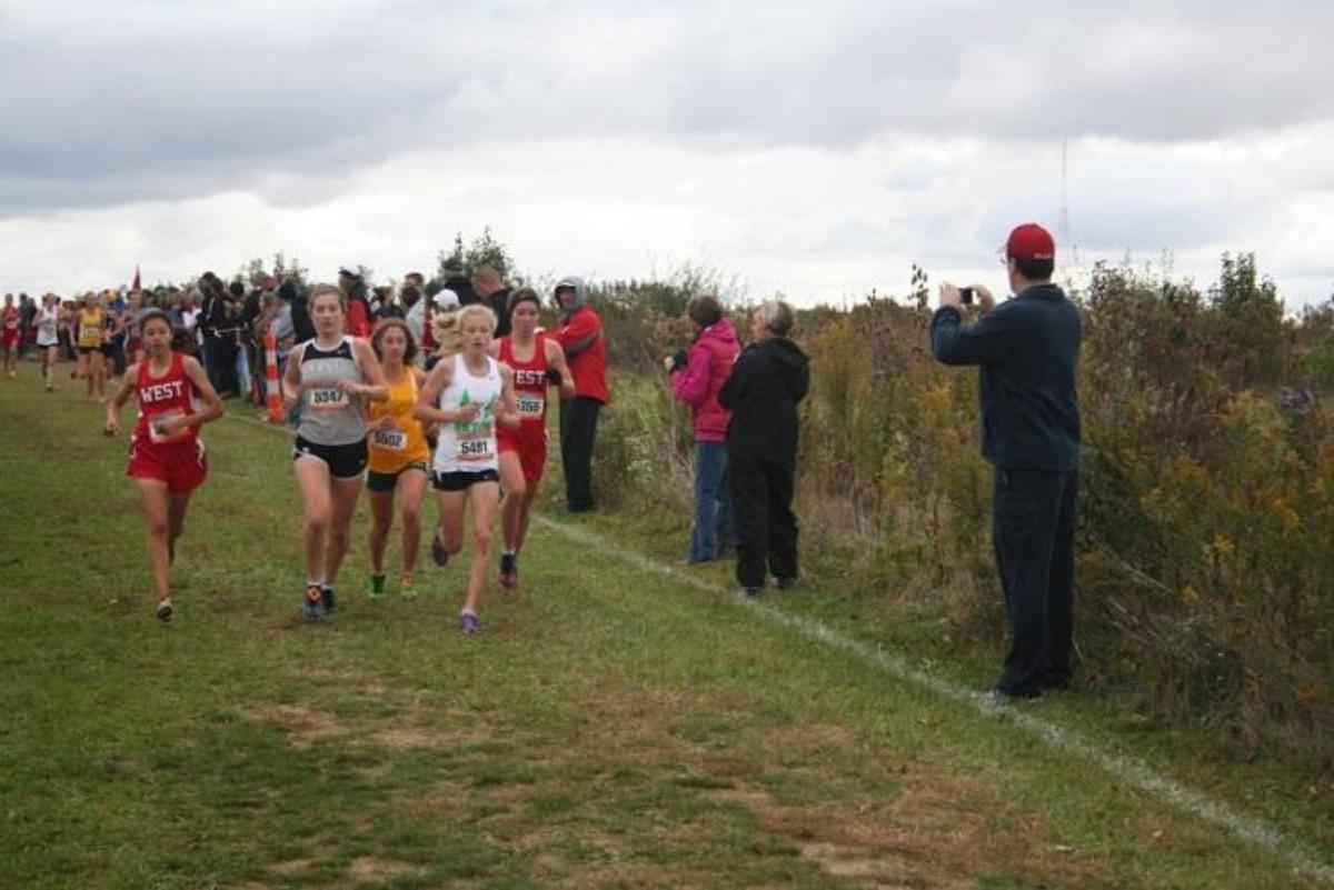 Rose Menyhert, 12, competes at the District championships at Voice of America  Park in Mason. Menyhert finished in third overall. She will race at Regionals and must place in the top 16 there in order to advance to State. Photo Courtesy of Becky Menyhert.