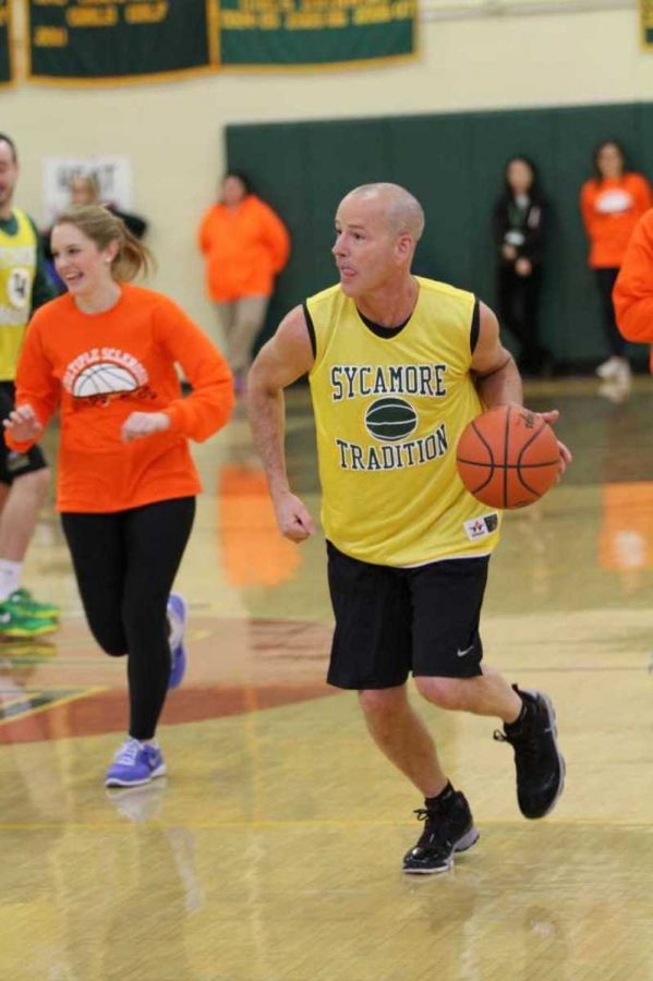Randall Lothrop, featuring a freshly shaven head, plays basketball against his students. The classic rivalry of students versus teachers was furthered during this pep rally. The students eventually won due to a last minute three pointer.