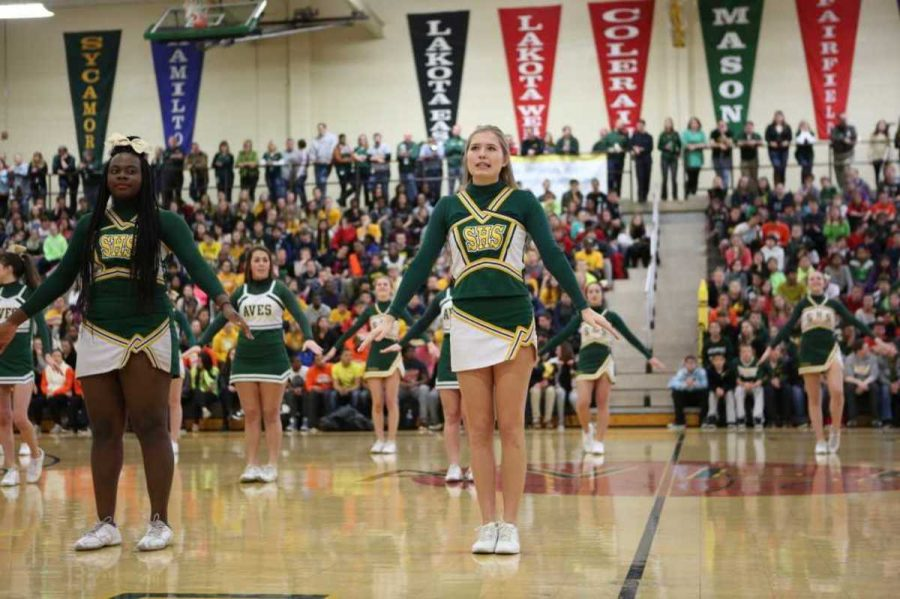 Senior Elizabeth Clark cheered in front of her student section during the rally. She is trying to motivate her class to win the spirit war the cheerleaders were conducting. No official winner was announced so all classes like to claim that they were the winners.