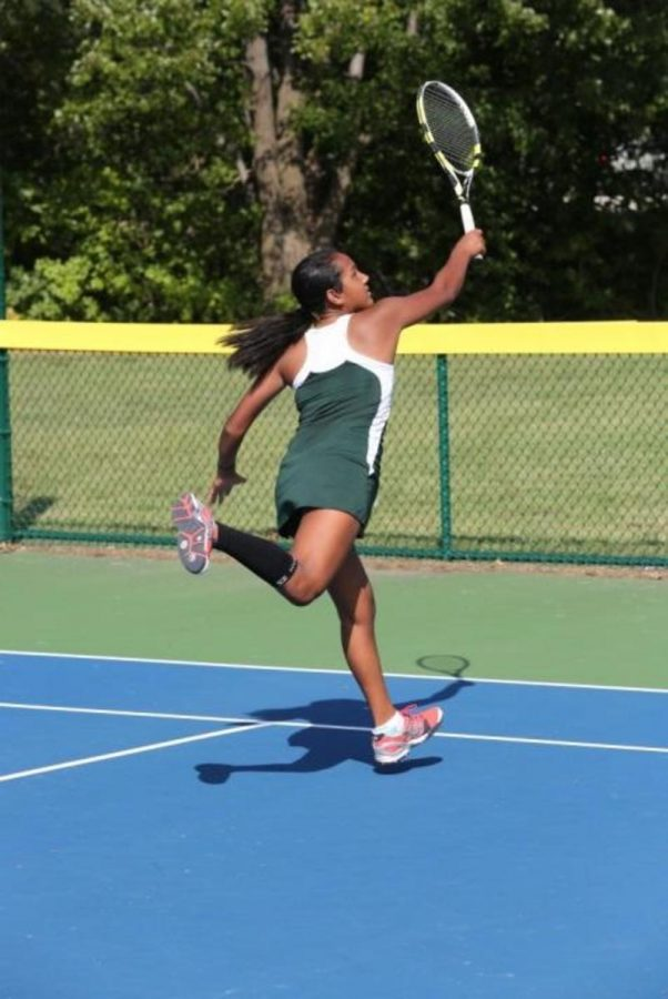 Freshman, Leah Wallihan lunges to hit a volley out of reach.  Coming to the net (moving up in the court to where you can hit the ball out of the air) is a common practice among players with good serves.