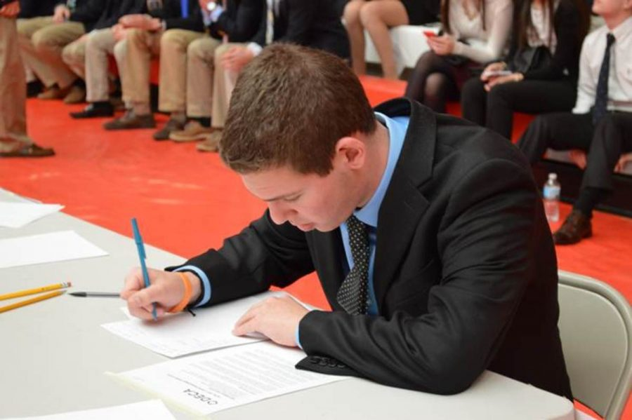 Junior Tyler Miller works on his role play in the hotel and lodging event. Unlike the previous competition, there is  no final round of role plays for students to compete in. This is Miller's only chance to ace his role-play and secure himself a spot at state.
