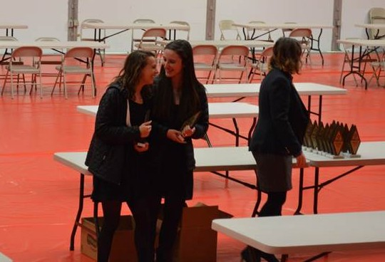Juniors Jennifer Reis and Alison Richter receive their DECA diamonds and accept their spot at state. The Sycamore DECA chapter is sending the most students to state than any other chapter in the area. The next closest number came from Indian Hill.