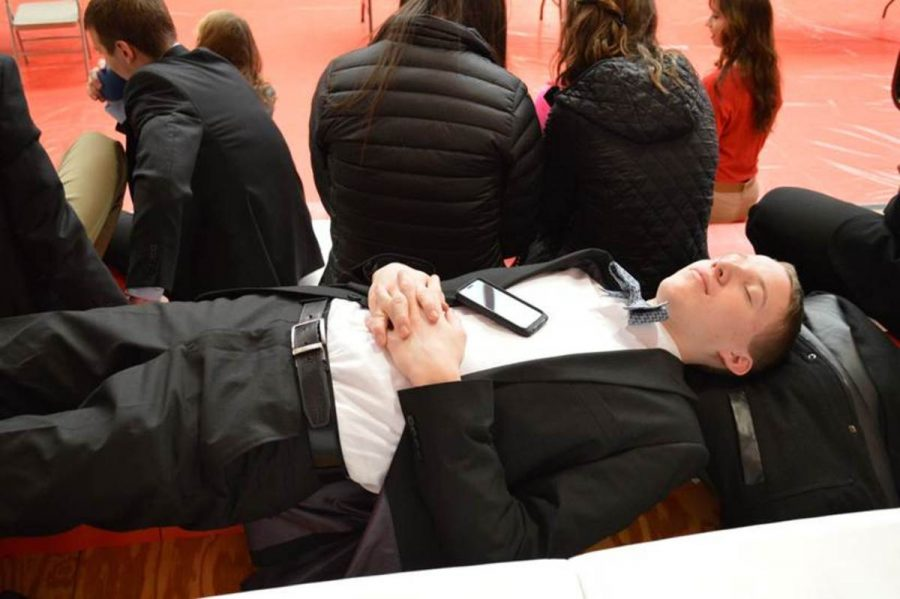 Senior Johnathan Lucken rests while waiting for the awards ceremony to begin. Awards were presented by a state officer at both the individual and team ceremonies. Lucken, teamed up with his twin brother Adam Lucken, placed first in the sports and entertainment team event.