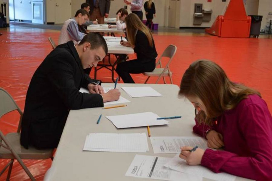 Juniors Raymond Berling and Julia Diersing work on their respective role plays. Once they take a seat they will have either eight or ten minutes to solve their problem, depending on what event they are in. They will then directly go to their presentation where the time is again regulated by the event they are competing in.
