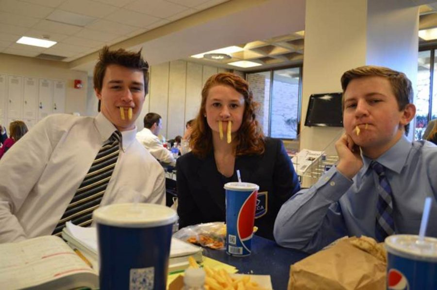 After the stress of competition wore off, the students went to the student center to hang out. Juniors Garrett Cambre, Gwen Constand and Samuel Meyers entertain themselves  while eating lunch. The students spent hours there playing pool, ping-pong or doing homework.