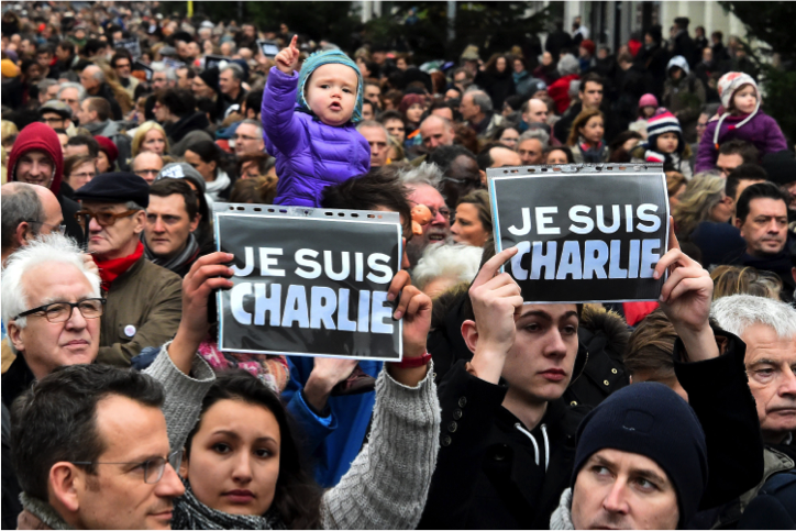 There+have+been+mass+protests+in+regard+to+Charlie+Hebdo%27s+controversial+publication.+The+cover+had+featured+the+Prophet+Muhammed+in+a+negative+light.+The+protesters+hold+signs+saying+%22Je+suis+Charlie%22+or%2C+%22I++am+Charlie%22+in+support+of+the+victims.+