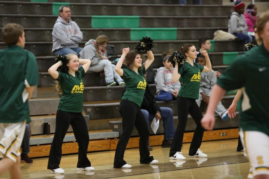 Junior+Calista+Robbins%2C+senior+Kathryn+Tenbarge%2C+and+senior+Leah+Brod+doing+their+sideline+pom+routine.+%E2%80%9CThe+sideline+dance+is+really+upbeat+and+fun+helps+us+with+our+jazz+and+hip+hop+dances%2C%E2%80%9D+Brod+said.+The+next+Varsity+boys%E2%80%99+home+game+is+on+Feb.+13+against+Colerain.+Photo+courtesy+of+McDaniel%E2%80%99s+Photography.+