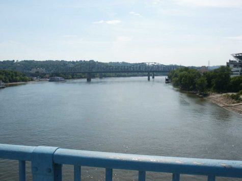 This photo is a shot of the Ohio River during summer. Now that spring is near, the Ohio River is slightly flooded, causing problems to settlements on the river. Roads are being flooded, and buildings are being flooded or damaged. Authorities say that the rainstorms may make things worse. Photo courtesy of MCT Photo.