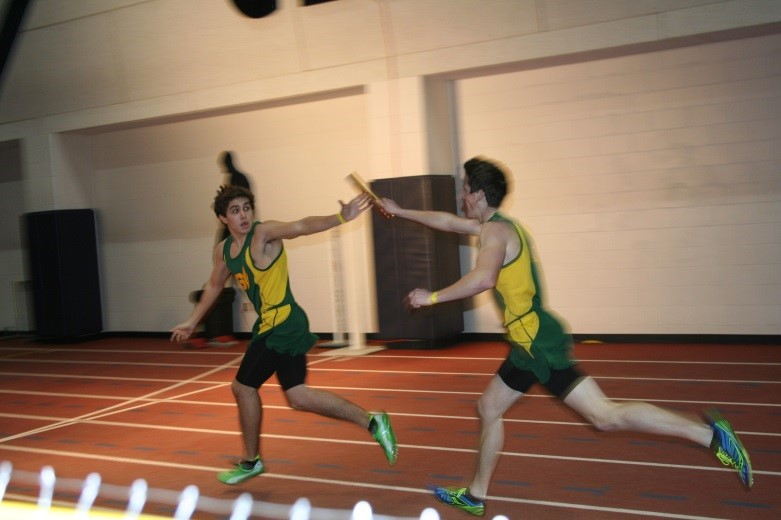 Senior+Adam+Lucken+passes+the+baton+to+junior+Jonathon+Hedrick+in+the+1600+meter+relay.+Lucken+pulled+a+hamstring+during+his+800+meter+race+at+the+M-F+Invitational+at+the+University+of+Findlay%2C+but+the+relay+still+qualified+for+the+Indoor+State+Track+and+Field+Championships.+Lucken+is+determined+to+be+healed+enough+to+compete+on+Saturday.
