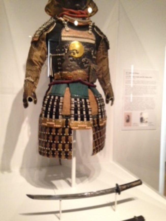 A Japanese set of samurai armor, dated to the Tokugawa dynasty.  This was the last dynasty under which Samurai existed.  Seen below the armor is a Samurai sword.